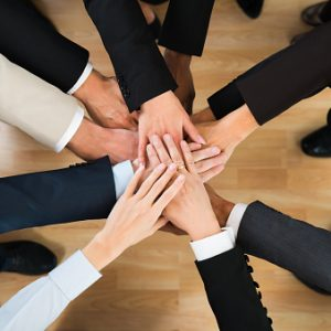 Business Team Stacking Hands On Table